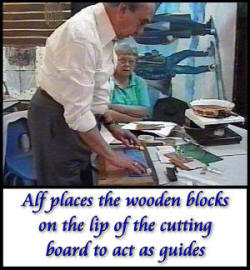 Alf places wooden blocks